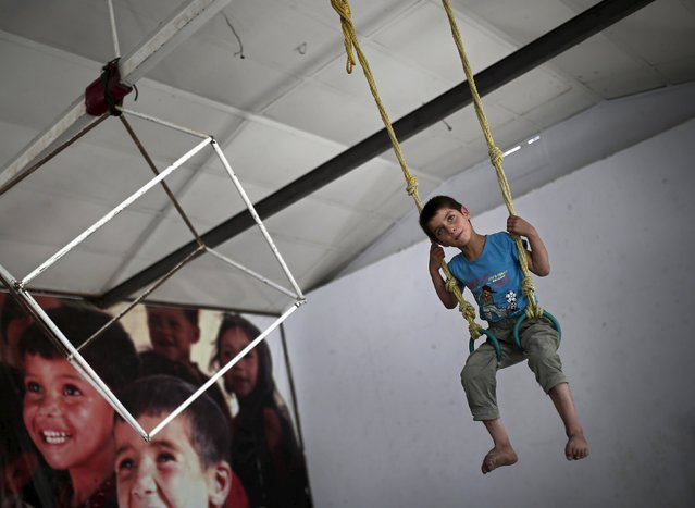 Yousuf, 8, who is part of the Afghan Mobile Mini Circus for Children (MMCC), practises in Kabul, Afghanistan August 17, 2015. (Photo by Ahmad Masood/Reuters)