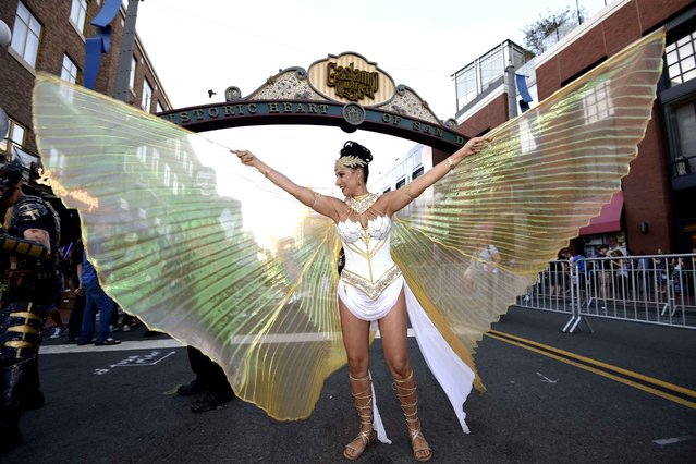 Isis Cress, dressed as the goddess Isis, poses for photographers outside of the convention center on day one of Comic-Con International held at the San Diego Convention Center Thursday July 21, 2016 in San Diego. (Photo by Denis Poroy/Invision/AP Photo)
