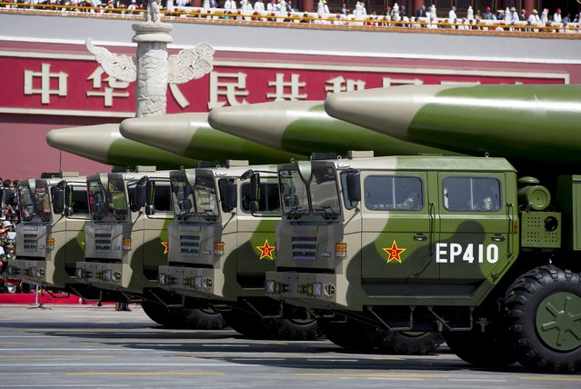 Military vehicles carrying DF-26 ballistic missiles travel past Tiananmen Gate during a military parade to commemorate the 70th anniversary of the end of World War II in Beijing Thursday September 3, 2015. (Photo by Andy Wong/Reuters)