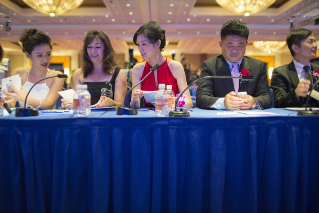 Judges Danni Wang, Bethany Seidel, Linda Sun, Deng Long and Robert So wait at their table for the pageant to start. (Photo and caption by John Brecher/Sahra Vang Nguyen/NBC News)