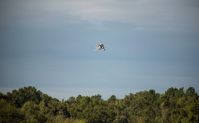 "The ""Mighty Eagle"" soars above the tree line on August 16, 2012. The vehicle was ""open loop"" – navigating autonomously without the command of the onboard camera and flying on a preprogrammed flight profile. This NASA robotic prototype lander sailed to an altitude of 100 feet during another successful free flight August 28 at NASA's Marshall Space Flight Center in Huntsville, Alabama. The test is part of a new series of free flights testing the robotic prototype lander's autonomous rendezvous and capture capabilities. (Photo by NASA/MSFC/Fred Deaton)"