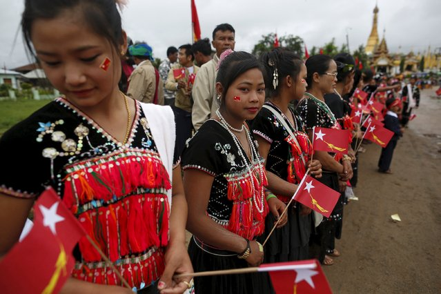 Women of the Yin Net ethnic group wait for the arrival of pro-democracy leader Aung San Suu Kyi at the Hopong township in Shan state, Myanmar September 6, 2015. (Photo by Soe Zeya Tun/Reuters)