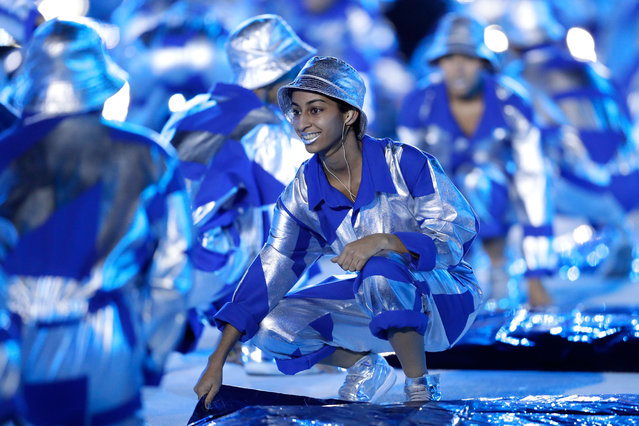 A performer dances during the Opening Ceremony of the Rio 2016 Olympic Games at Maracana Stadium on August 5, 2016 in Rio de Janeiro, Brazil. (Photo by Jamie Squire/Getty Images)