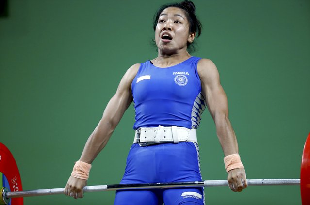 2016 Rio Olympics, Weightlifting, Final, Women's 48kg, Riocentro, Pavilion 2, Rio de Janeiro, Brazil on August 6, 2016. Mirabai Chanu Saikhom (IND) of India grimaces as she competes. (Photo by Kai Pfaffenbach/Reuters)