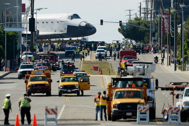 The space shuttle Endeavour is transported to the California Science Center in Exposition Park from Los Angeles International Airport (LAX) on October 12, 2012 in Los Angeles, California. (Photo by Kevork Djansezian)