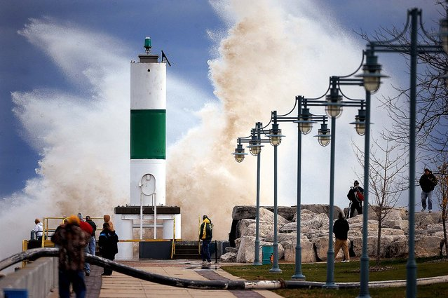 A large crowd is drawn to the Lake Michigan shoreline in Kenosha, Wis. to watch big waves caused by winds from superstorm Sandy. (Photo by Bill Siel/The Kenosha News)