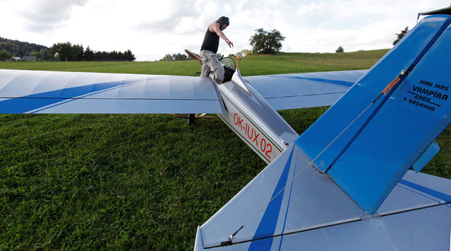 Aviator Frantisek Hadrava gets in Vampira, an ultralight plane based on the U.S.-design of light planes called Mini-Max, near the village of Zdikov, Czech Republic, August 23, 2016. (Photo by David W. Cerny/Reuters)
