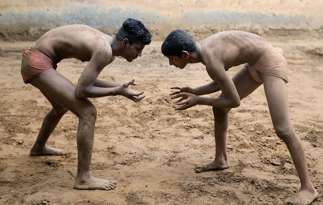 Wrestlers practice on a dirt ground at Maharishi Dayanand Akhara, a traditional wrestling school, in Sarfabad, on the outskirts of New Delhi, India 29 June 2020. According to the Sukhbir Singh, an army veteran and former National wrestler who runs the akhara, around hundred people used to train in his akhara before the coronavirus lockdown. (Photo by Harish Tyagi/EPA/EFE)