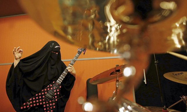 Gisele Marie, a Muslim woman and professional heavy metal musician, plays her Gibson Flying V electric guitar during a rehearsal at a studio in Sao Paulo January 27, 2015. (Photo by Nacho Doce/Reuters)