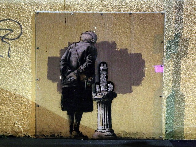 A mural called Art Buff created by street artist Banksy which has been vandalised this weekend in Folkestone, Kent, on October 12, 2014. (Photo by Gareth Fuller/PA Wire)