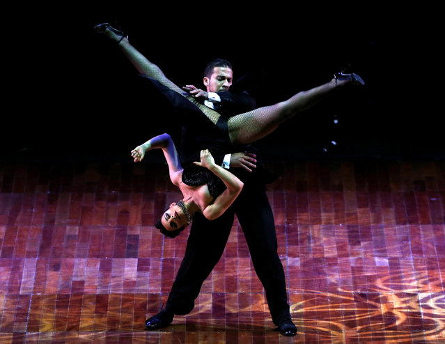 Valentin Arias Delgado and Diana Franco Durango, from Colombia, perform their routine at the Stage style Tango World Championship, in Buenos Aires, Argentina, August 31, 2016. (Photo by Enrique Marcarian/Reuters)