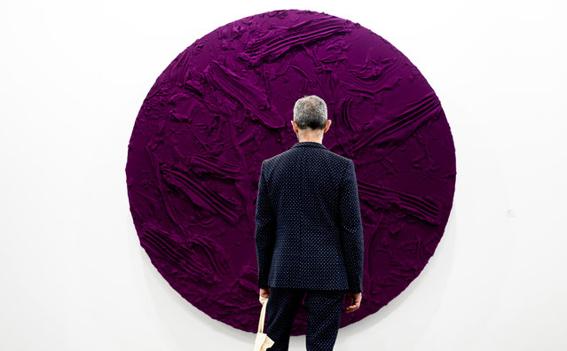 Visitor observes pictures during the 39th International Contemporary Art Fair (ARCO) held in Madrid, at Ifema on February 26, 2020 in Madrid, Spain. (Photo by Samuel de Roman/Getty Images)