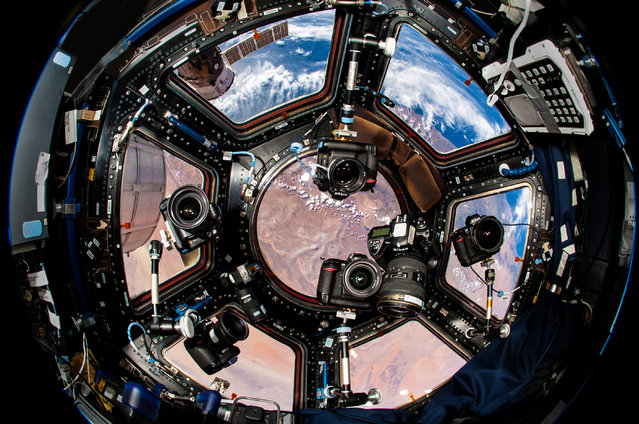 Astronaut Donald R. Pettit would often rig an array of as many as six cameras in the cupola windows and set them all to fire continuously for events such as sunsets, which only last around seven seconds on the ISS. (Photo by Donald R. Pettit)