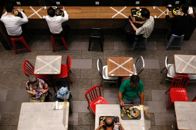 Social distancing marks are seen at a restaurant following the coronavirus disease (COVID-19) outbreak in Hong Kong, China on July 27, 2020. (Photo by Tyrone Siu/Reuters)