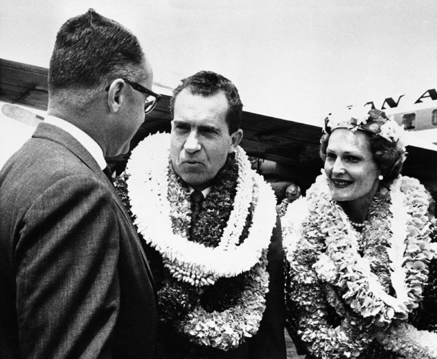 Vice President Richard M. Nixon and Mrs. Pat Nixon chat with Hawaiian Gov. William F. Quinn at plane side after their arrival, August 3, 1960 in Honolulu to kickoff Nixon?s presidential campaign in the nation's newest state. The Nixons wear only a few of the leis given them by the Hawaiian Republicans who greeted them. Nixon will visit the four major islands during his grueling two-day visit here. (Photo by AP Photo)