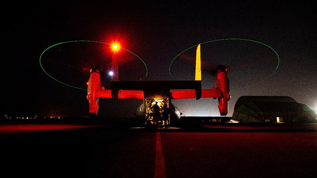 In this photo provided by U.S. Department of Defense, the Army's AH-64 Apache helicopter from 1st Battalion, 227th Aviation Regiment, 34th Combat Aviation Brigade, prepares to conduct overflights of the U.S. Embassy in Baghdad, Iraq, Tuesday, December 31, 2019. Helicopters later launched flares as a show of presence while providing additional security and deterrence against protesters. (U.S. Army photo by Spc. Khalil Jenkins, CJTF-OIR Public Affairs via AP Photo)