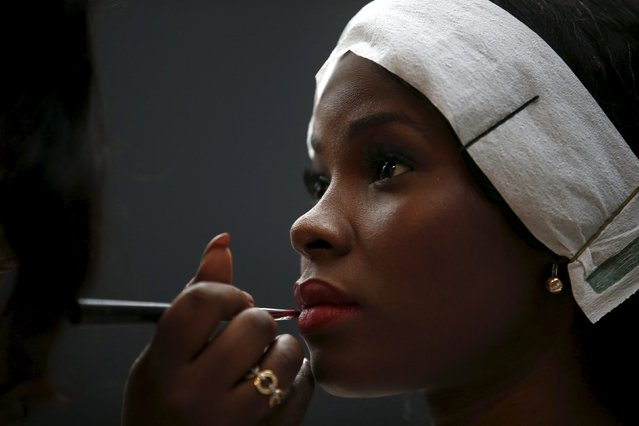 A model is prepared backstage before Nadir Tati show during Lisbon Fashion Week, Portugal October 11, 2015. (Photo by Rafael Marchante/Reuters)