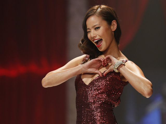 Actress Jamie Chung presents a creation during The Heart Truth's Red Dress Collection fashion show in New York. (Photo by Carlo Allegri/Reuters)