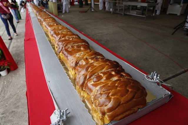 A giant ham bread, a typical Venezuelan Christmas dish, is seen on a table during an attempt to break the Guinness World Record for the biggest ham bread, in Caracas November 15, 2014. (Photo by Carlos Garcia Rawlins/Reuters)