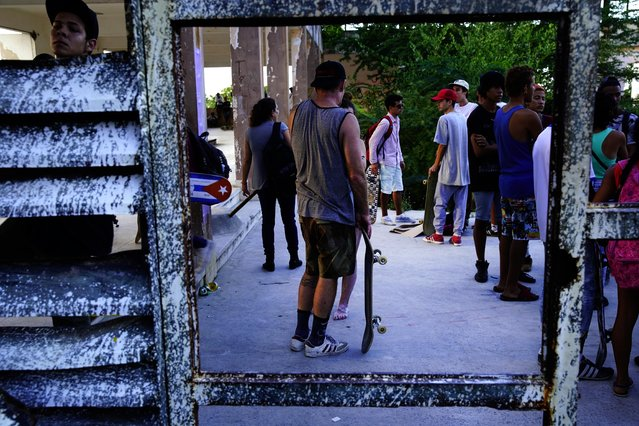 In this January 11, 2018 photo, skaters gather for the inauguration of a new recreational space for skateboarders, created in an abandoned gym at the Educational complex Ciudad Libertad, a former military barracks that the late Fidel Castro turned into a school complex after the revolution in Havana, Cuba. Cuba's government allowed the creation of another, now-deteriorating skate facility at the Metropolitan Park more than a decade ago. (Photo by Ramon Espinosa/AP Photo)