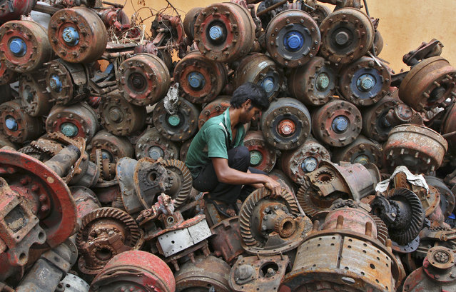 A man works at an iron scrap yard at an industrial area in the southern Indian city of Chennai August 9, 2012. (Photo by Reuters/Babu)