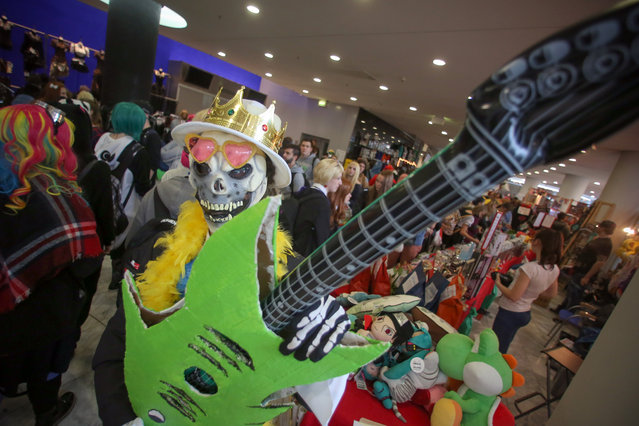 """A cosplayer dressed as """"Brook"""" (Comic One Piece) visits the comic- and cosplay hall at the Frankfurt Book Fair on October 17, 2015 in Frankfurt am Main, western Germany. (Photo by Fredrik von Erichsen/AFP Photo/DPA)"""