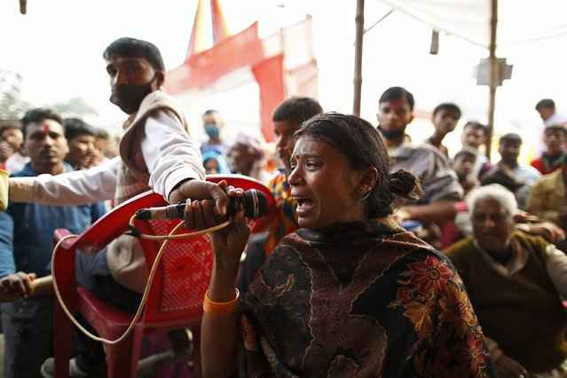 "Bina Devi Kalwar cries while she calls for her lost nine-year-old daughter Komal Kumari Kalwar on a microphone at the lost and found camp after getting separated in the crowd during the ""Gadhimai Mela"" festival held in Bariyapur November 29, 2014.She was separated from her daughter last night and the whereabouts of her daughter is still unknown. (Photo by Navesh Chitrakar/Reuters)"