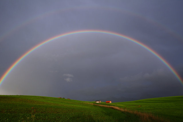 A rainbow is pictured over farm buildings near Hopferau, southern Germany, Wednesday, August 13, 2014. (Photo by Karl-Josef Hildenbrand/AP Photo/DPA)