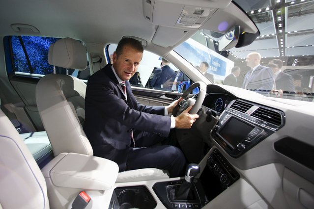 Volkswagen Passenger Cars CEO Herbert Diess poses for pictures behind the wheel in a new Tiguan GTE at the 44th Tokyo Motor Show in Tokyo October 28, 2015. Diess said on Wednesday he did not think demand for cars had peaked in China, as worries persist over the impact on global automakers from the weakness in the world's biggest auto market. (Photo by Thomas Peter/Reuters)
