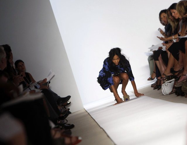 A model falls as she presents a creation from Peter Som Spring/Summer 2009 collection at New York Fashion Week September 8, 2008. (Photo by Joshua Lott/Reuters)