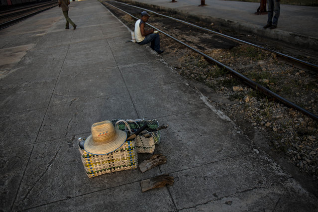 In this March 23, 2015 photo, tools that belong to a train maintenance worker sit alongside the tracks before the start of his work day in San Luis, near Santiago de Cuba, Cuba. (Photo by Ramon Espinosa/AP Photo)