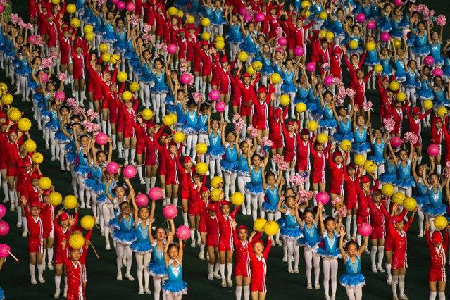 North Koreans children dance during an Arirang mass games performance in Pyongyang, North Korea, on Sunday, September 9, 2012. (Photo by David Guttenfelder/AP Photo)
