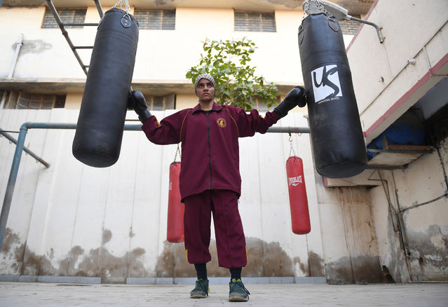 Razia Banu, 20, a Pakistani female national boxing champion, poses for a picture before a practice session at a boxing club in Lyari, Karachi's most restive – and sporty – neighbourhood, on February 20, 2018. (Asif HassanPhoto by /AFP Photo)