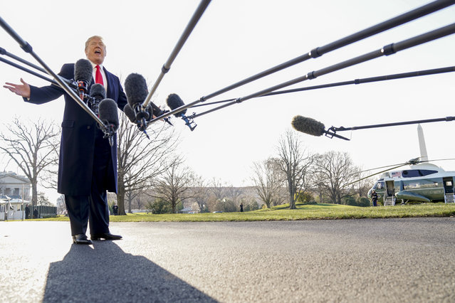 President Donald Trump speaks to reporters before boarding Marine One on the South Lawn of the White House in Washington, Tuesday, March 13, 2018, to travel to Andrews Air Force Base, Md. Trump is beginning a two day trip to California and St. Louis. (Photo by Andrew Harnik/AP Photo)