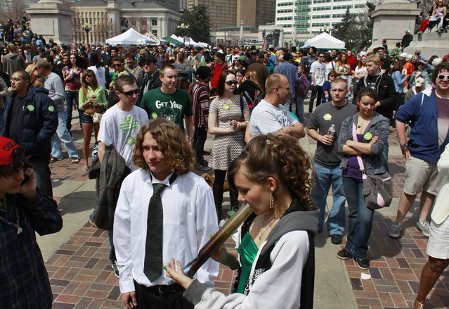 Youths smoke marijuana at the Denver 4/20 pro-marijuana rally at Civic Center Park in Denver, Saturday, April 20, 2013. Even before the passage in November 2012 of Colorado Amendment 64, which promised the legalization of marijuana for recreational use, April 20th has for years been a celebration of marijuana counterculture, and the 2013 rally was expected to draw larger crowds than previous years. (Photo by Brennan Linsley/AP Photo)