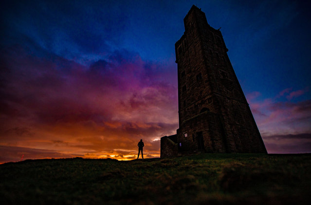 A colourful morning sunrise on Christmas Eve at Victoria Tower on Castle Hill, West Yorkshire, England on December 24, 2017. The history of human activity on the Castle Hill goes back over 4000 years. The site was developed as an iron age hill fort, surrounded by defensive ditches and ramparts. In the Middle Ages there was a castle on the hill, of which the well remains. The present tower was built to commemorate Queen Victoria's Diamond Jubilee of 1897. (Photo by Charlotte Graham/ZUMA Wire/Rex Features/Shutterstock)