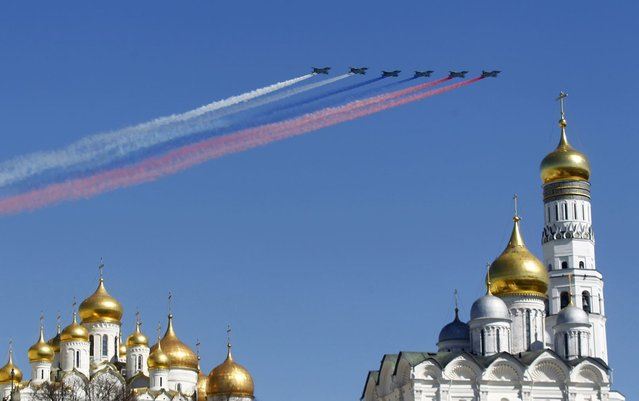 Military jets fly over an Orthodox Christian church during a rehearsal for the Victory Day parade in Moscow, May 7, 2013. Russia marks victory over Nazi Germany in World War Two every year on May 9. (Photo by Mikhail Voskresensky/Reuters)