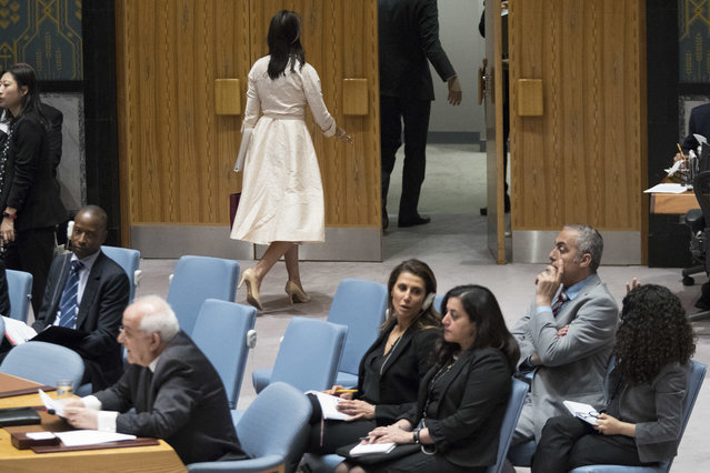 U.S. Ambassador to the United Nations Nikki Haley, top center, leaves the room as Palestinian Ambassador to the United Nations Riyad Mansour, right, prepares to address a Security Council meeting on the situation in Gaza, Tuesday, May 15, 2018 at United Nations headquarters. (Photo by Mary Altaffer/AP Photo)
