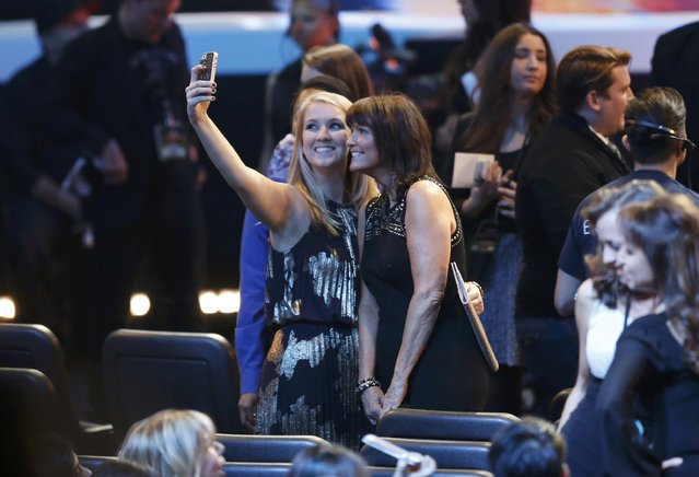 Members of the audience take selfies during the 2015 People's Choice Awards in Los Angeles, California January 7, 2015. (Photo by Mario Anzuoni/Reuters)