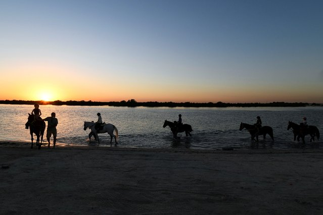 Yasmin Sayyed, founder of the Ride to Rescue program, holds a horse-riding class at a beach as a treat for a young student's birthday, in Abu Dhabi, United Arab Emirates on October 21, 2020. (Photo by Khushnum Bhanda/Reuters)