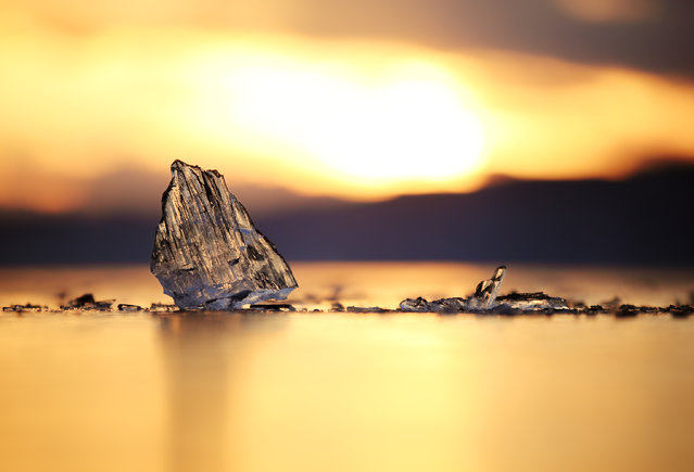 """Ice On the Lake"". I was walking around Lake Baikal at sunset and spotted this ice. I laid on the cold, frozen surface with my zoom lens and took this picture. Location: Lake Baikal, Russia. (Photo and caption by Edward Graham/National Geographic Traveler Photo Contest)"