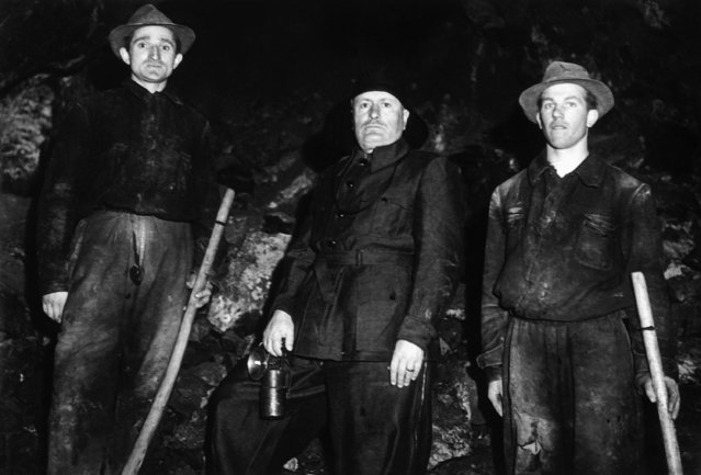 Italian dictator Benito Mussolini, during his tour of Piedmont, donned a coal-miner's kit and descended a coal mine at Cogne, Piedmont, on May 22, 1939. (Photo by AP Photo)