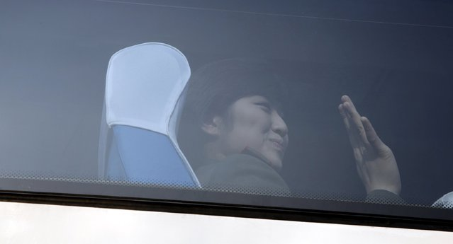 A member of the Moranbong Band from North Korea waves inside a bus as she leaves a hotel in central Beijing, China, December 11, 2015. (Photo by Reuters/Stringer)