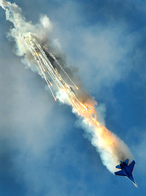 A Russian SU-27 combat aircraft performs on July 4, 2013 during the International Maritime Defence Show  in St. Petersburg. (Photo by Olga Maltseva/AFP Photo)
