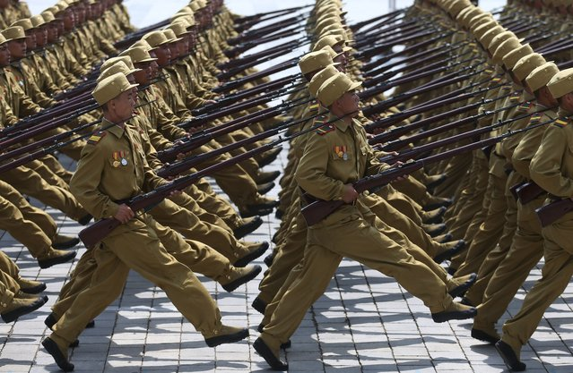 North Korean soldiers march past the Kim Il Sung Square, Saturday, July 27, 2013 during the mass military parade celebrating the 60th anniversary of the Korean War armistice in Pyongyang, North Korea. (Photo by Wong Maye-E/AP Photo)