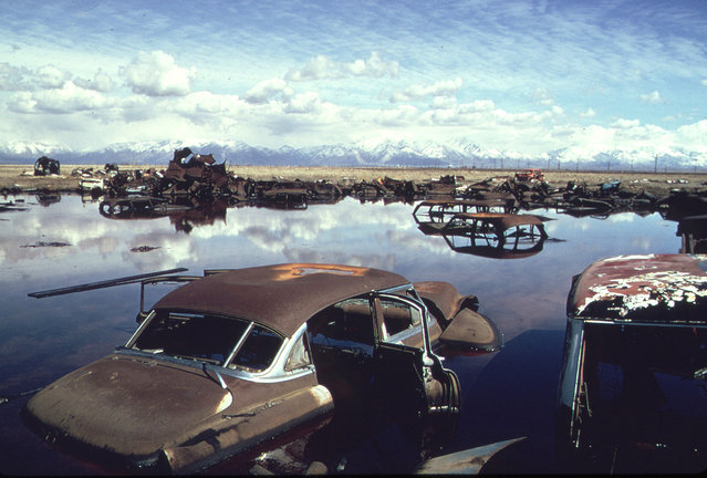 Abandoned automobiles and other debris clutter an acid water and oil filled five acre pond near Ogden, Utah, in April of 1974. It was cleaned up under EPA supervision to prevent possible contamination of the Great Salt Lake and a wildlife refuge nearby. (Photo by Bruce McAllister/NARA via The Atlantic)