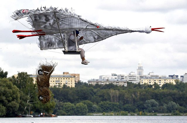 A participant attempts to control his craft during the Red Bull Flugtag Russia 2013 competition, on July 28, 2013. (Photo by Maxim Shemetov/Reuters)