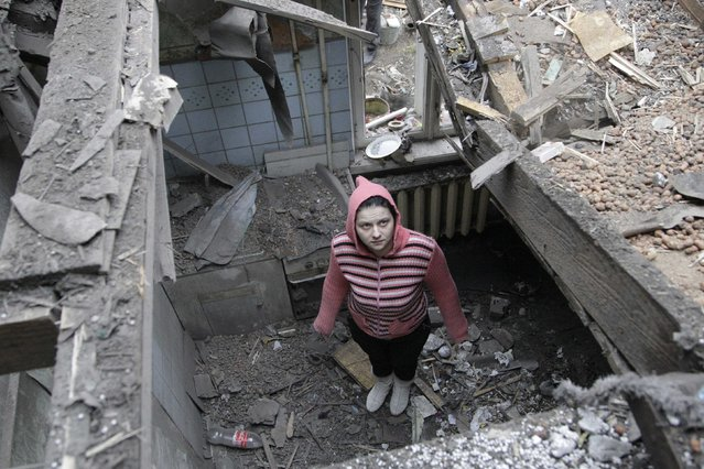 A woman stands in her house, which was damaged by recent shelling, in central Donetsk, eastern Ukraine, February 2, 2015. (Photo by Alexander Ermochenko/Reuters)