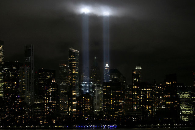 The Tribute In Light shines above the skyline of lower Manhattan on the eve of the 19th anniversary of the September 11, 2001 attacks on the World Trade Center in New York City, as seen from Jersey City, New Jersey, U.S., September 10, 2020. (Photo by Mike Segar/Reuters)