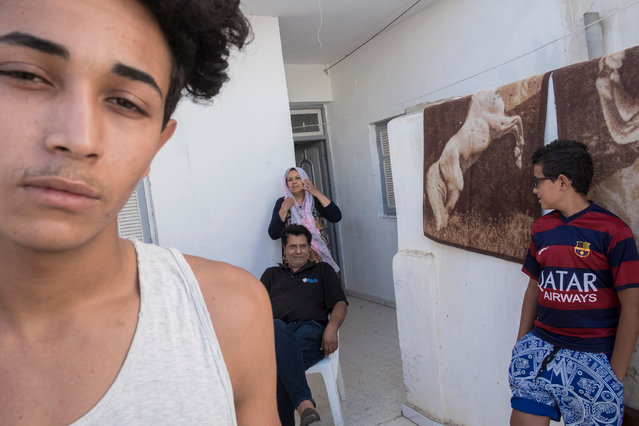 Guesmi pictured with his parents and younger brother. He lost his legs in an accident in 2002. (Photo by Yassine Alaoui Ismaili/The Guardian)